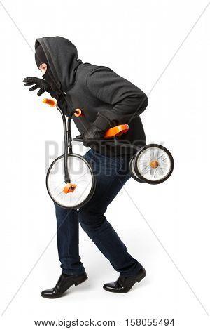 Burglar steals little children's bicycle