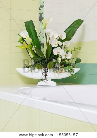 Beautiful white orchid flower decor in bathroom design