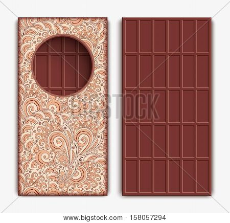 Chocolate bar in ornamental wrapper and unpacked on white