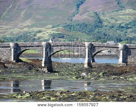 Medieval bridge of eilean donan castle in August, Scotland