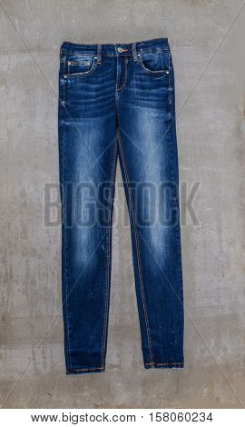 blue jeans, detail-gray background