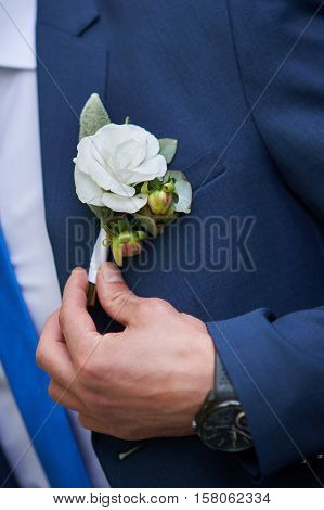 groom dress boutonniere on a jacket in wedding day