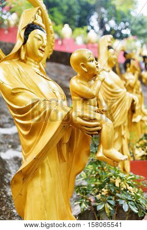 Golden Buddha Statues Along The Stairs Leading To The Ten Thousand Buddhas Monastery In Shatin, Hong