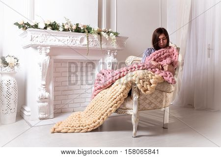 Girl with large knit blanket s giant knit blanket super chunky yarn arm knitting