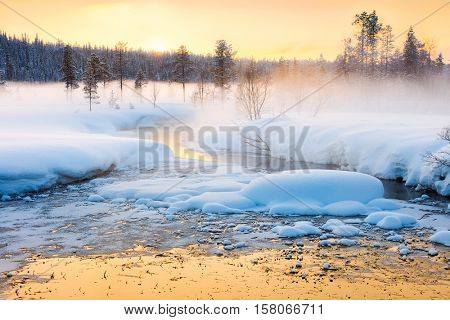 Winter sundown in forest and river with beautiful misty fog, fantastic winter nature landscape, wallpaper