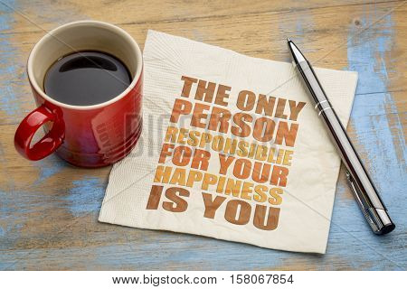 The only person responsible for your happiness is you - word abstract on a napkin with a cup of coffee