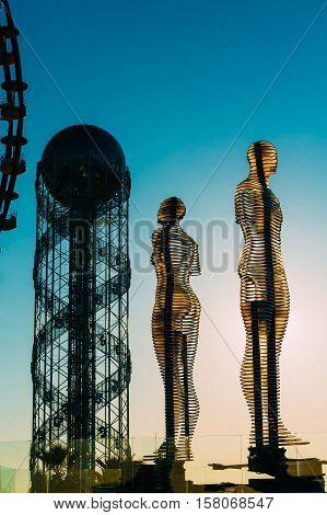 Batumi, Adjara, Georgia - May 25, 2016: A moving metal sculpture created by Georgian sculptor Tamara Kvesitadze in 2007, titled Man and Woman or Ali and Nino.