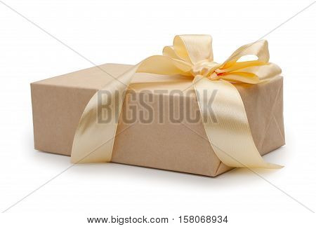 Gift Box With Present Wrapped In Kraft Paper And Gold Yellow Bowknot Bow. Isolated On White Backgrou