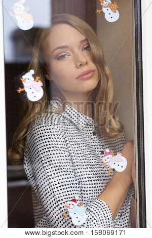 Stunning Woman Behind Window Pane