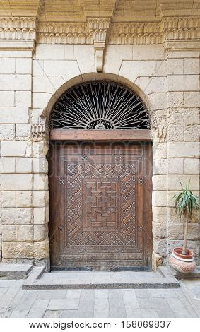 Cairo, Egypt - November 19, 2015: Door leading to Bayt Al-Suhaymi an old Ottoman era house in Cairo Egypt built in 1648 along the Darb al-Asfar a very prestigious and expensive part of Medieval Cairo