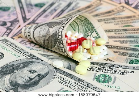 heap of paper dollars and medical pills and tablets