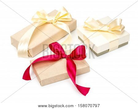 Set Of Three Of Gift Boxes With Presents Wrapped In Kraft Paper And With Golden And Red Bow Isolated