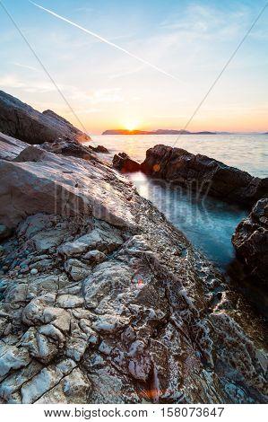 Beautiful seascape near Dubrovnik in the Adriatic sea at sunset. Colorful summer sunset in Dalmatia, Croatia, Europe. Artistic style post processed photo.