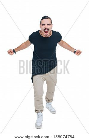 young emotional guy with a mustache in a black shirt screams angrily smiling, arms outstretched