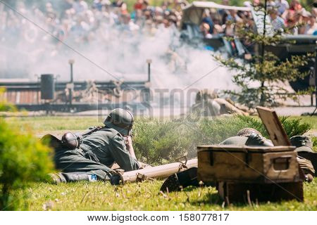 Gomel, Belarus - May 9, 2016: Back View Of Two Wehrmacht Soldiers Reenactors Recreate The Battle Of WW2 With Soviet Armed Forces. Scene Of Historical Reenactment  On Celebrating Victory Day 9 May
