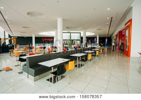 Tbilisi, Georgia - May 24, 2016: Free food court tables stand in a shopping center mall East Point