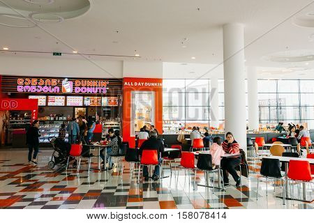 Tbilisi, Georgia - May 24, 2016: Visitors popular cafe Dunkin Donuts at the modern shopping mall East Point