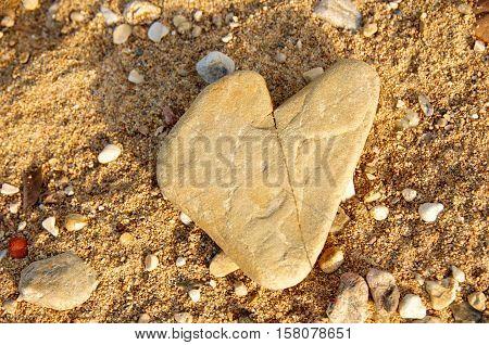heart shaped flat stone found on the shore of Lake Tanganyika - Kigoma Tanzania