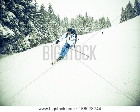 Man skiing on slope - winter holidays