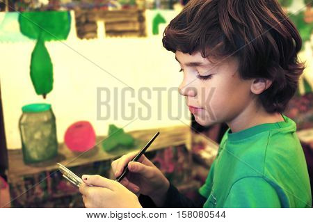 teen handsome boy painting picture still life in art class school close up portrait