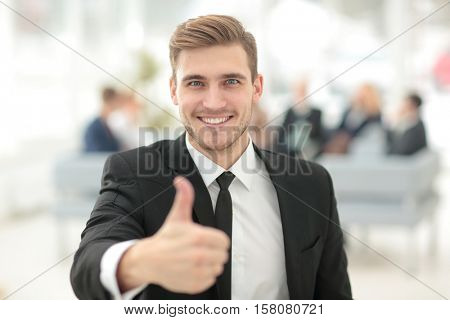 Portrait of happy businessman with  colleagues interacting on ba