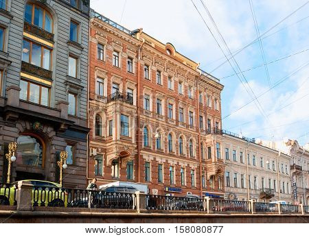 ST PETERSBURG RUSSIA-OCTOBER 3 2016. Historic buildings at Griboyedov Canal in St Petersburg Russia. In the middle is former apartment house belonged to a rich merchant Stepan Ivanovich Krundyshev.