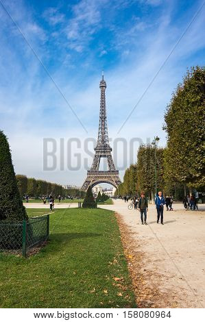 PARIS FRANCE - OCTOBER 12 2015: The Eiffel Tower is a wrought iron lattice tower on the Champ de Mars in Paris France