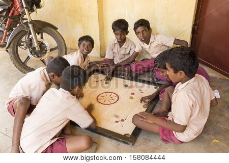 Pondichery, Tamil Nadu, India - Marsh 07 2014. Shool boys and girls with uniforms, in the class room. Indian education in a public school.