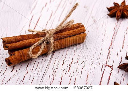 Banch Of Cinnamon Lies On White Wooden Table
