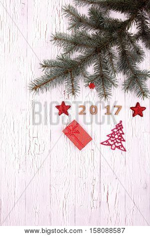 Numbers And Spruce Twigs With Christmas Decoration Lying On White Floor