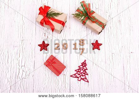 Red Christmas Stars And Present Boxes Lie Around Wooden Numbers 2018 And 2017