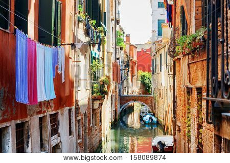 Laundry Drying On Clothesline Above Canal Of Venice