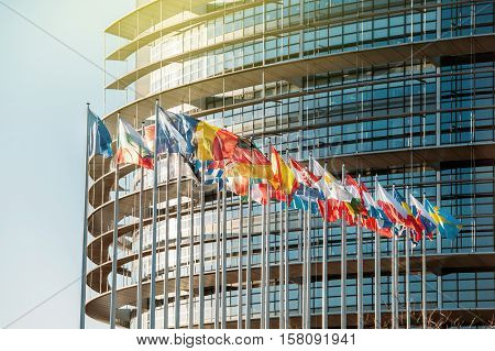 STRASBOURG FRANCE - JAN 28 2016: Impressive European Parliament building in Strasbourg France with flags waving on a spring evening