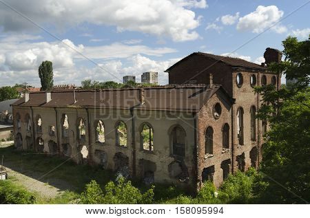 Ruins of abandoned sugar factory in suburbs