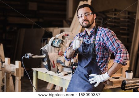 portrait of smiling construction worker pointing with finger at camera.