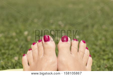 Barefoot woman feet. Feet look good. Red nails.