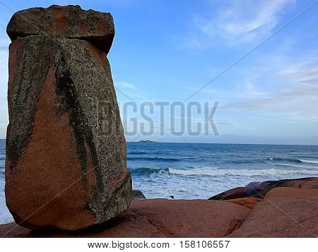 View of the Friar's Stone (Pedra do Frade) on rocky base by the sea. Laguna county, Brazil