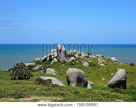 Hill with crown of rocks by the sea
