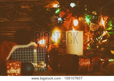 Christmas decoration with candle and mistletoe. Light garland. Greeting card