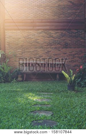Chair in garden with copy space. Selective focus and soft flare sunlight.