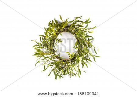Christmas wreath with mistletoe isolated on white background. Christmas decoration