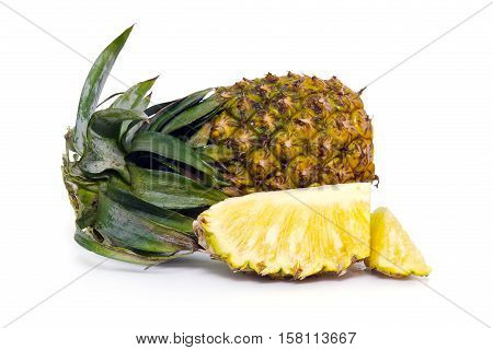 Fresh Pineapple Fruit With Sliced Pieces Isolated On White