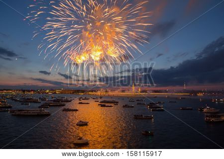 Ships and boats on Neva river and fireworks at night in St. Petersburg, Russia