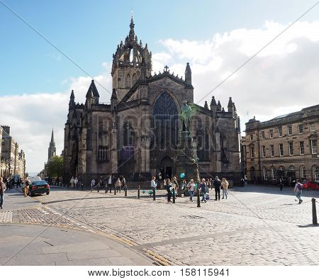 EDINBURGH-SEPT. 22: Tourists are seen on the Royal Mile by St. Giles Cathedral in Edinburgh Scotland on Sept. 22 2016.