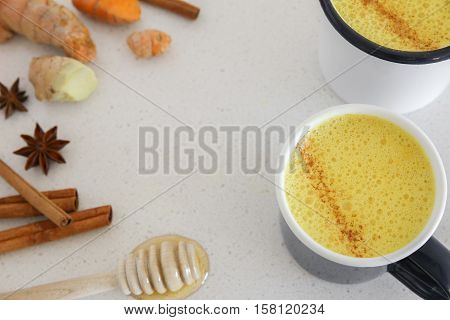 Turmeric latte Golden milk Turmeric milk made from turmeric almond mink cinnamon ginger and honey healthy hipster drink
