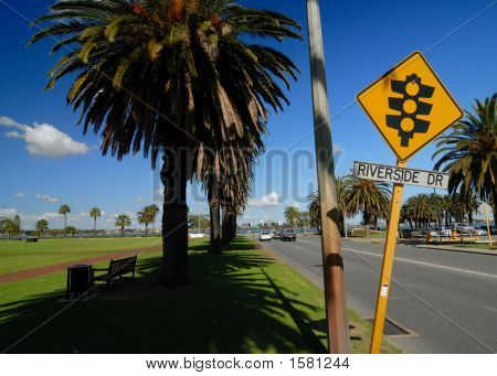 Street sign and road near riverside