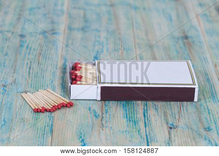 new Red Matchbox on color wood background