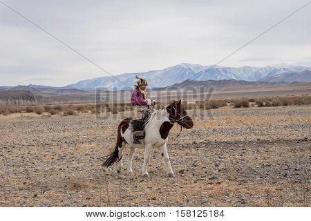 Beautiful Mongolian Girl Traditionally Wearing Typical Mongolian Fox Dress Culture Of Mongolia. She