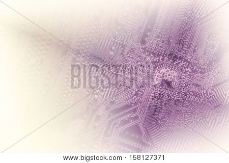 Closeup Of Computer Micro Circuit Board, Toned Into Violet Colors And Faded Into White At The Sides.