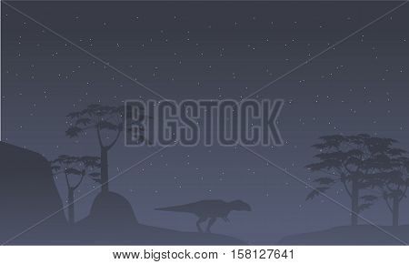 Silhouette of mapusaurus with tree scenery collection stock
